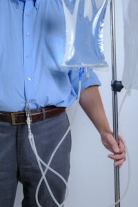 Peritoneal Dialysis user with catheter and saline bag